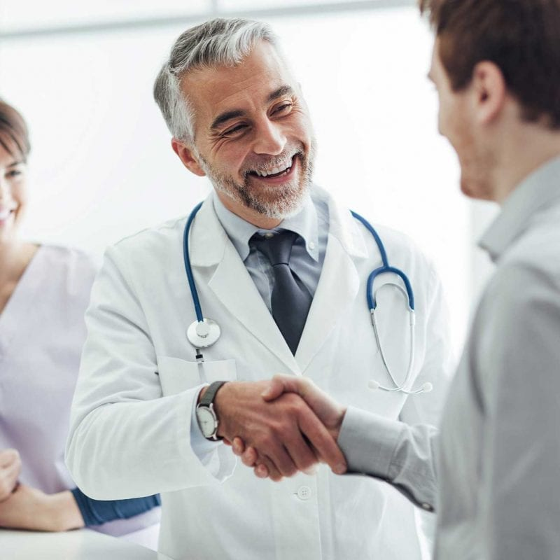 doctor greeting male patient