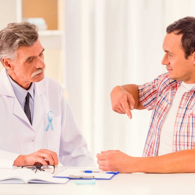 patient explaining issue to doctor