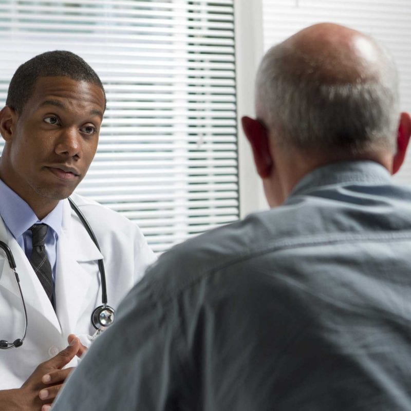 serious doctor with male patient